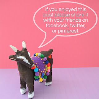 Little papier mache goat with speech bubble asking for social media shares