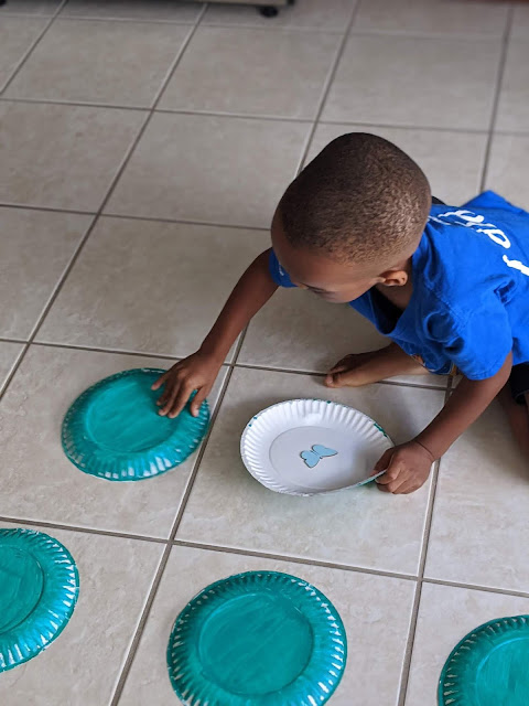 African-American boy playing a memory game at home