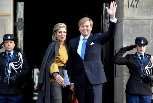 Princess Beatrix and Princess Margriet. Queen Maxima wore Natan top and skirt, Gianvito Rossi suede pumps, Travelteq work bag