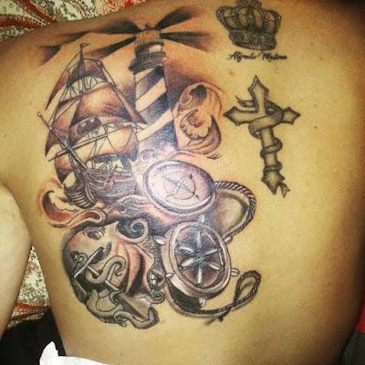 Tattoo de faro con calamar