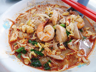 Sarawak Laksa are normally topped with prawns, chicken and eggs