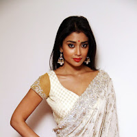 Gorgeous and stylish Tollywood actress shriya latest white designer saree stills
