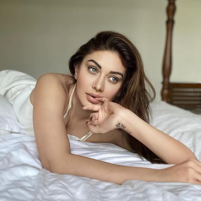 Shefali Jariwala Poses on Bed in night dress