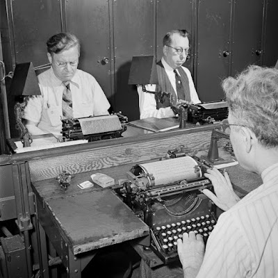 In the wire room, telegraphers record messages received by Western Union and Postal Telegraph from Times correspondents across the United States and abroad.
