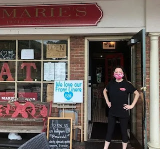 Carl Ruiz's ex-wife Marie Riccio picture in front of her restaurant