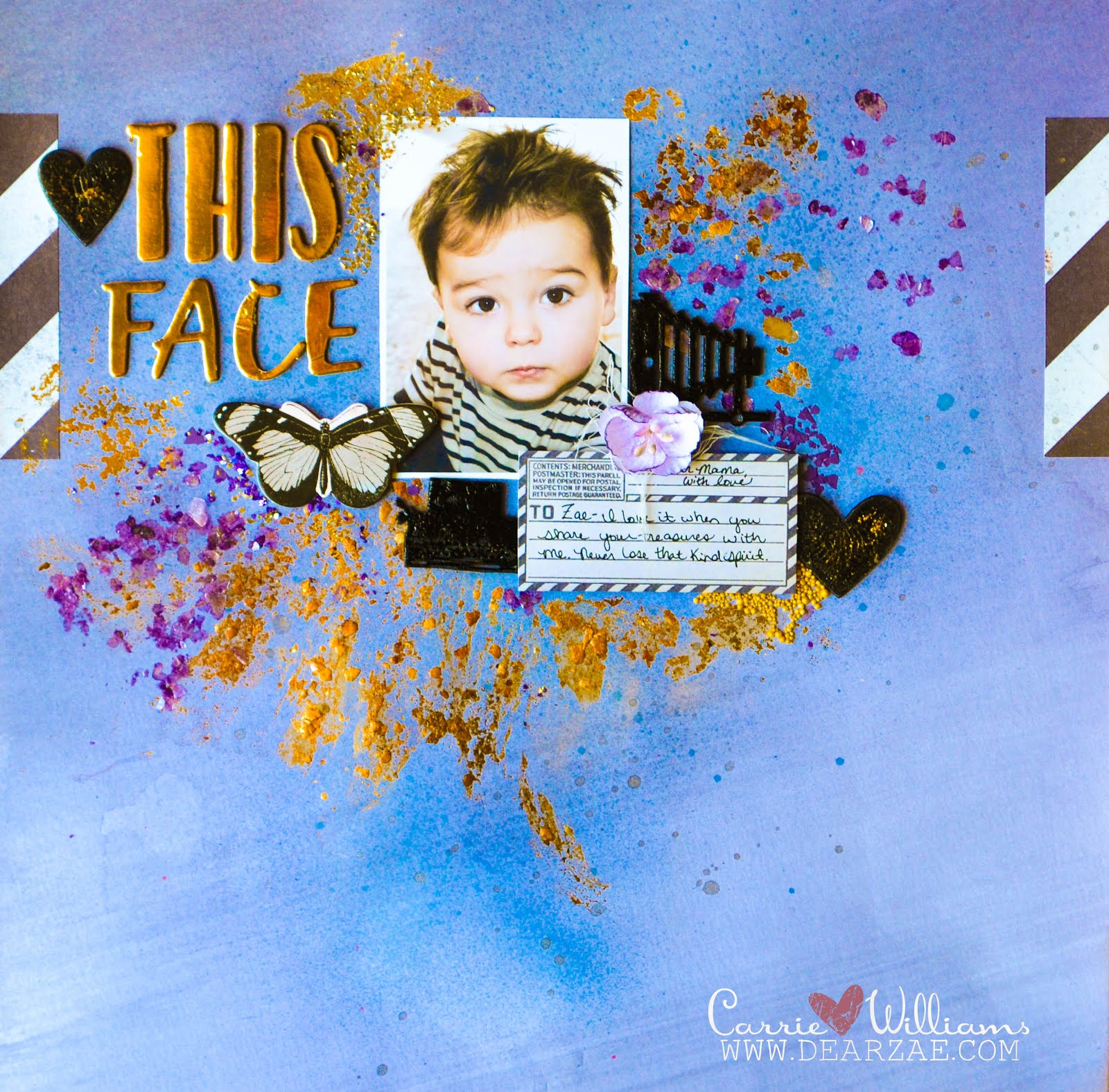 Scrapbooking page layout in purple, blue, gold, and black, with gold foil thickers, chipboard, Prima wooden typewriter and camera icons, die cut hearts, with gold and purple mica and mixed media elements (glimmer sprays and pearlescent watercolors)