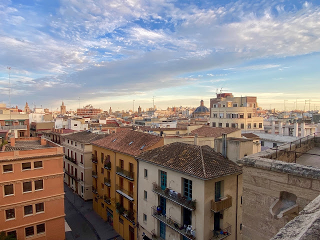View of the historic old town at dusk from the Torres de Quart, Valencia, Spain