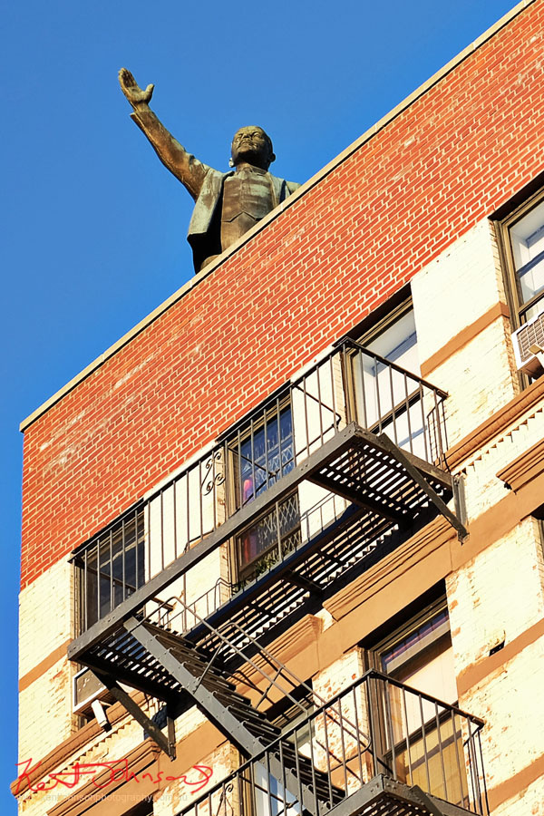 A roof top statue of Vladimir Ilyich Lenin greets New York. Street Fashion Sydney - New York Edition photographed by Kent Johnson