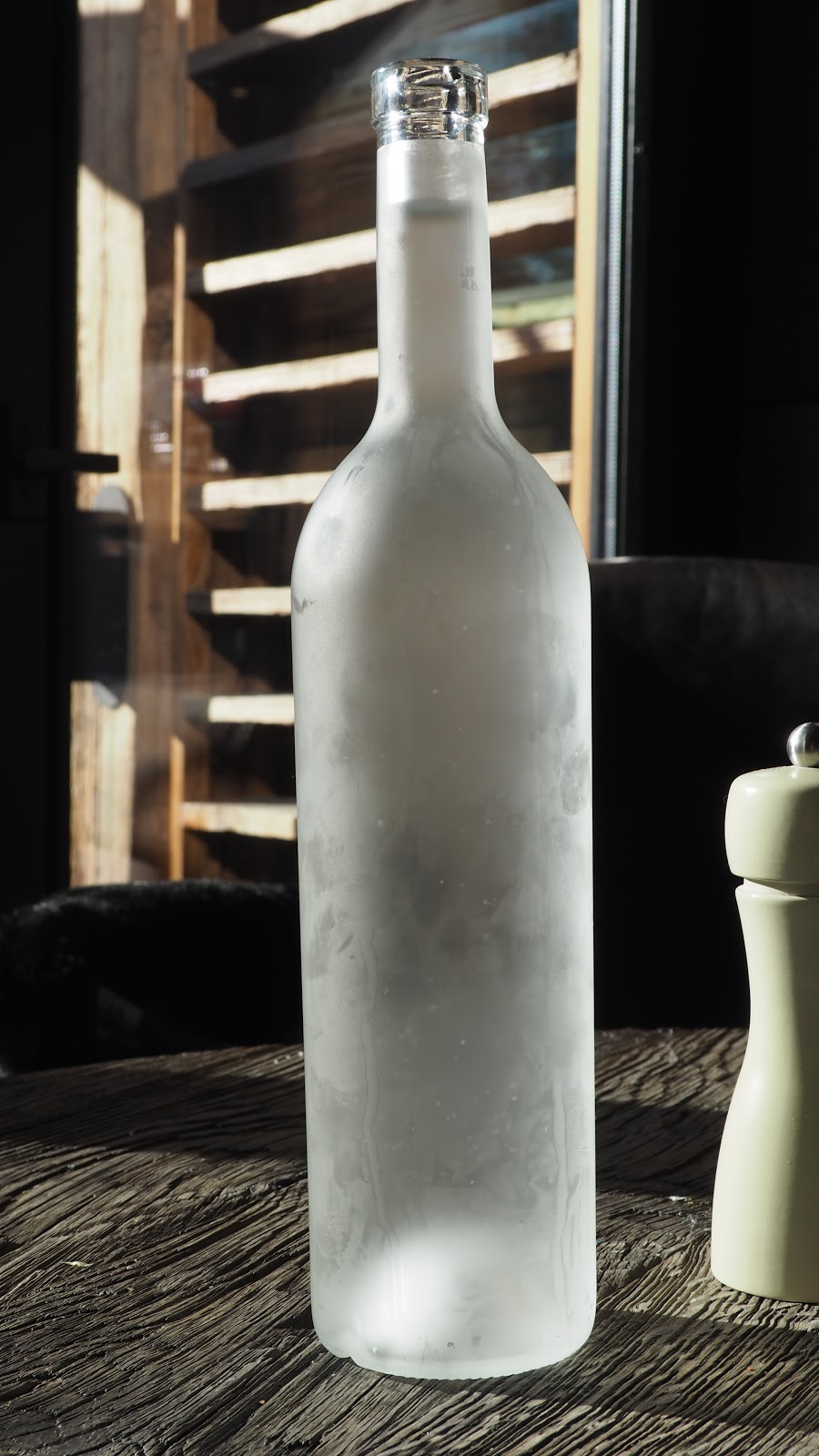 Glass bottle of water, La Baraque interior in Val d'isere, France
