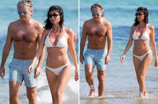 Silvia Fortini enjoying in the beach with her husband Roberto