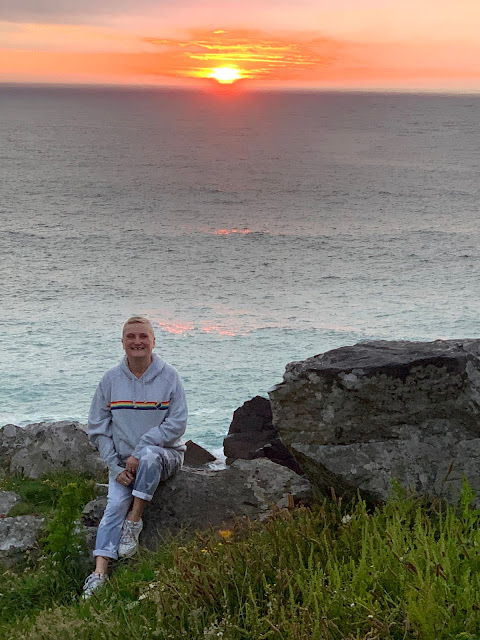 madmumof7 sitting on rock in St Ives at Sunset