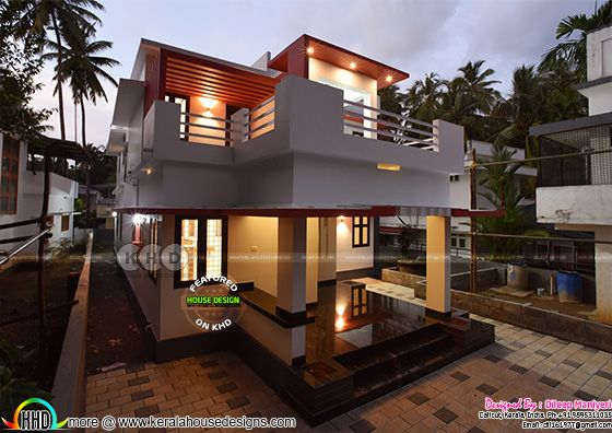 Night photograph of furnished house in Kerala