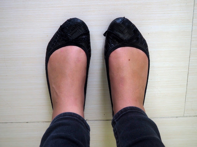 Nightfall - outfit shoe details of flat black ballet pumps with bows, worn with grey skinny jeans