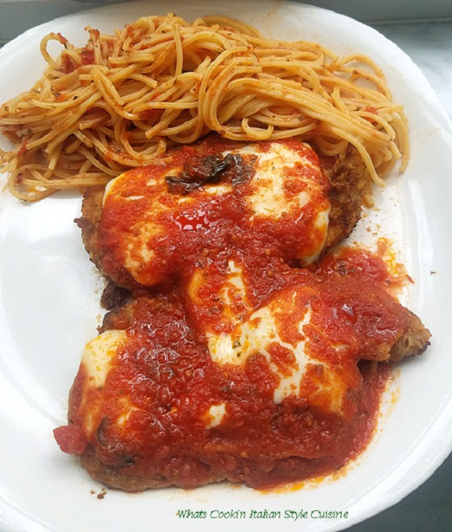 this is chicken parmesan with angel hair pasta on a white plate