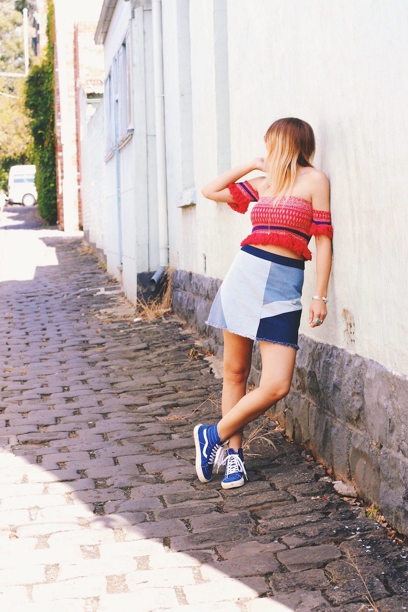 Festival Outfit Idea by Stone Fox Style shot in Fitzroy, Melbourne Victoria Australia. Fringe bohemian crop top with handkerchief print and patchwork denim skirt from Akira worn with vans for the perfect functional festival outfit