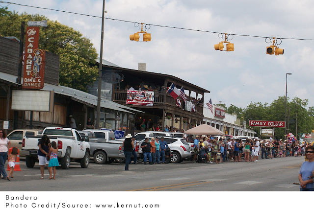 folks outside on Bandera's Main Street during an event