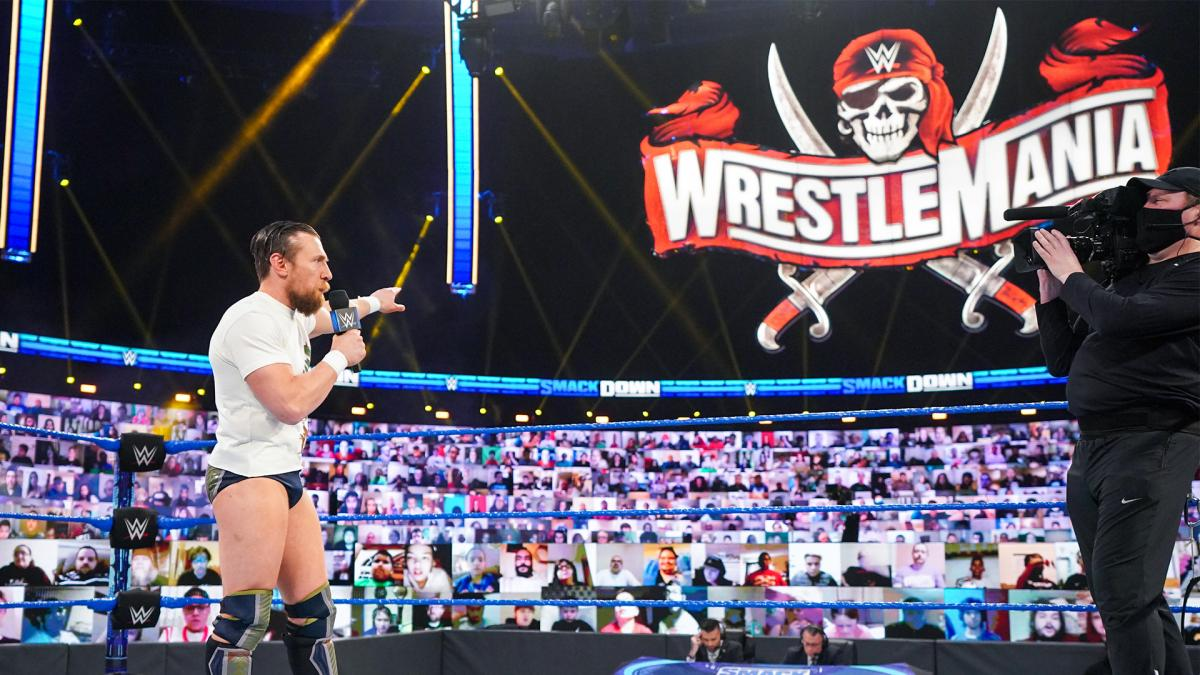 Daniel Bryan pointing to WWE WrestleMania sign on WWE SmackDown