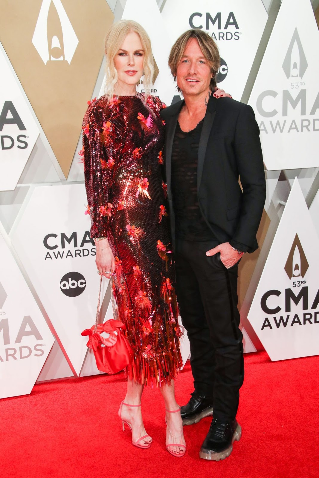 Nicole Kidman dazzles in red sequins as she walks the red carpet with husband Keith Urban at CMA Awards in Nashville