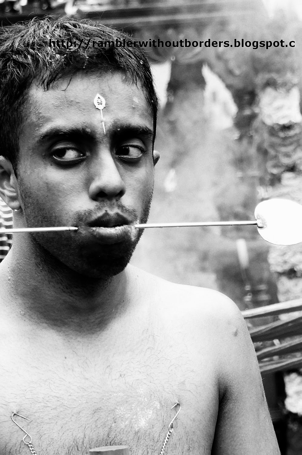 Devotee with cheek piercing during Thaipusam Festival, Singapore