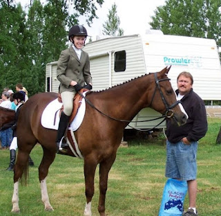 Katelyn Sweet teenage picture while sitting horse with her father Don