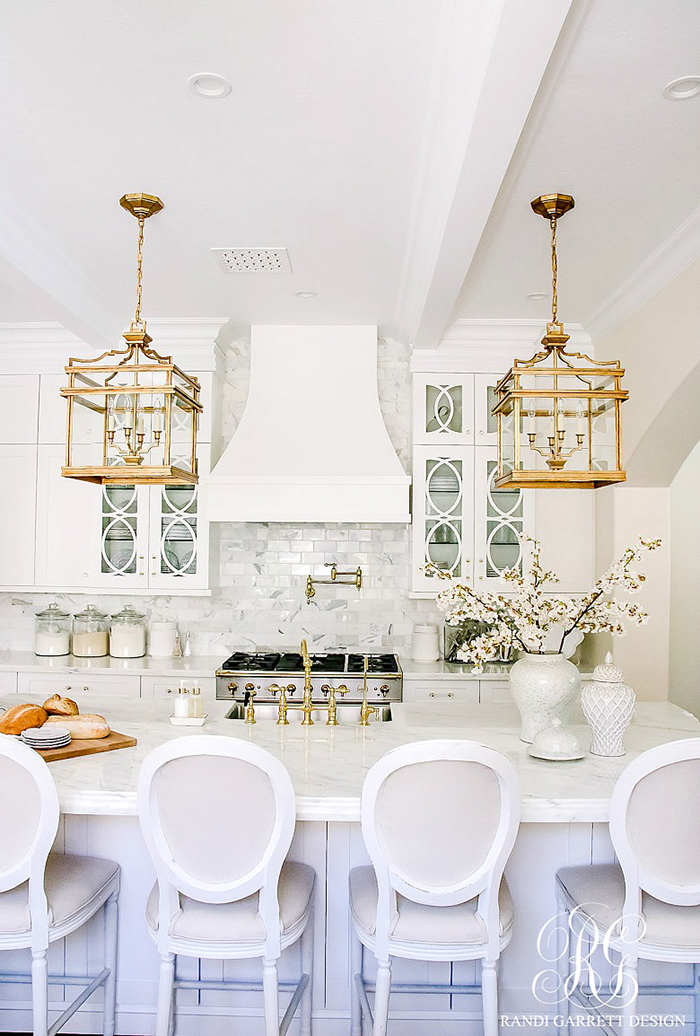 Brass, gold, marble, and, white cabinets and island kitchen inspiration | via monicawantsit.com
