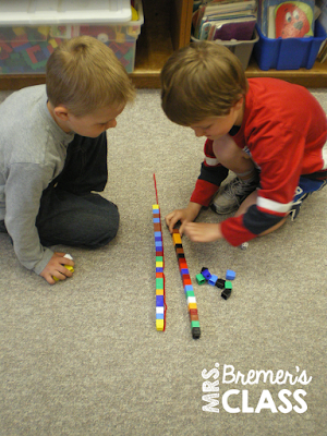 Kindergarten measurement partner activity that includes addition and comparing lengths- just need yarn, dice, and Unifix cubes. See post for how to play!
