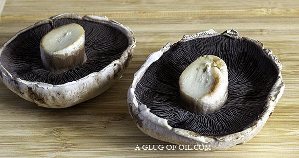 two large flat mushrooms