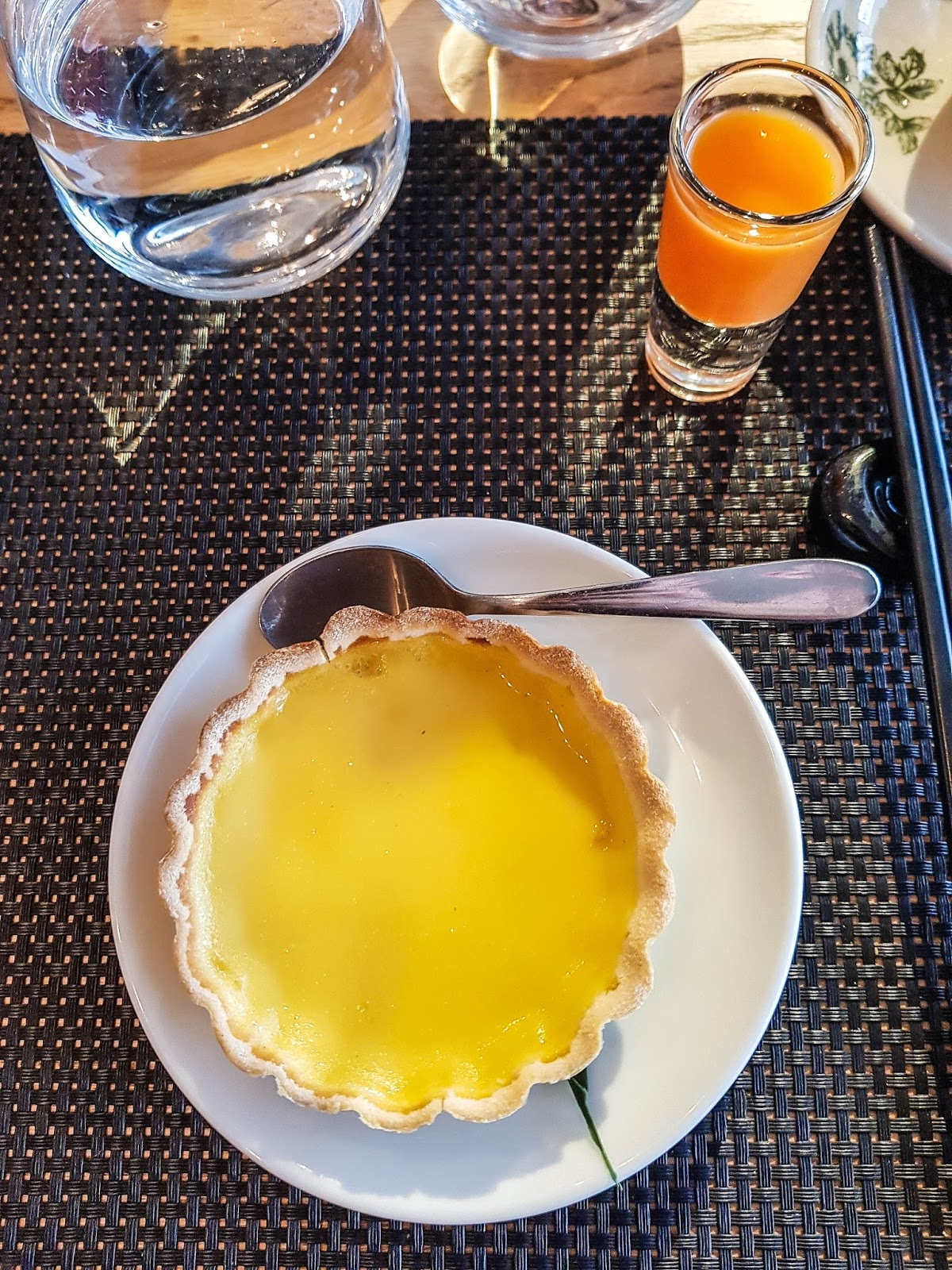 Chinese Egg Tart and carrot, ginger and orange shot