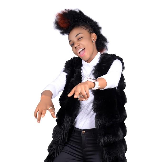 Commissioner DJ Wysei' AKA (Drummer girl)