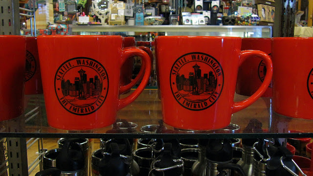 Mugs commemorate the Emerald City... and they are red!?