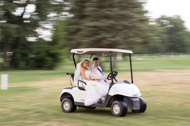bride and groom in golf cart at Fern Hill Golf Course