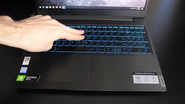 Keyboard flex testing is underway on Lenovo IdeaPad L340 laptop.
