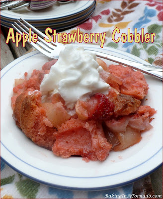 Apple Strawberry Cobbler, fall meets summer. Fresh fruit is baked with a crunchy strawberry cookie topping.   recipe developed by www.BakingInATornado.com   #recipe #dessert