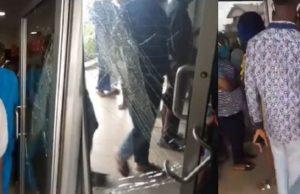 Watch how Customers break down door in order to get into the bank in Lagos (Video)