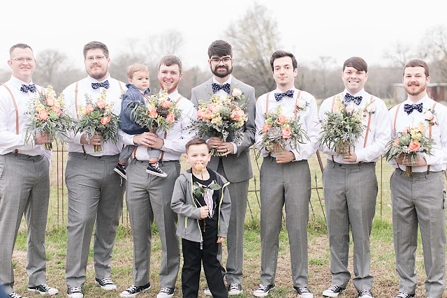 Gruene Estate New Braunfels Texas wedding venue, groomsmen holding bouquets photos