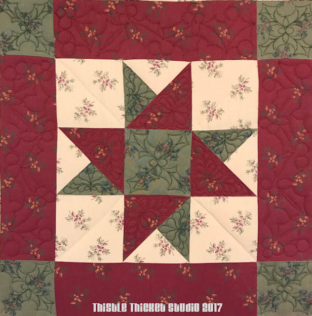 Spinning Stars Christmas Quilt by Thistle Thicket Studio. www.thistlethicketstudio.com