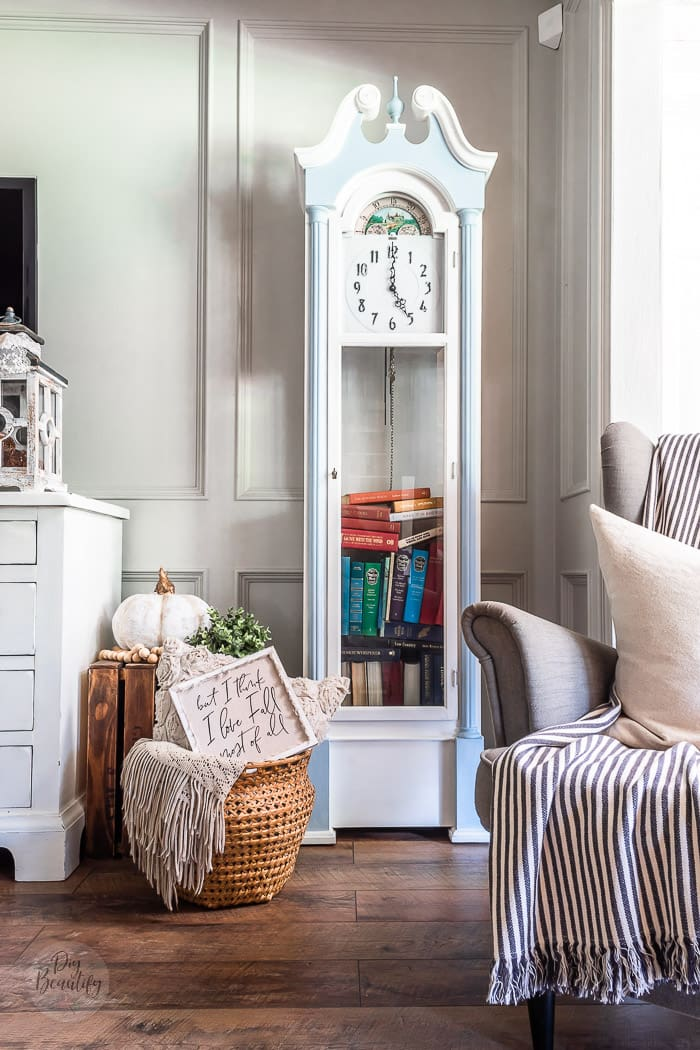 grandfather clock painted blue and white filled with vintage books