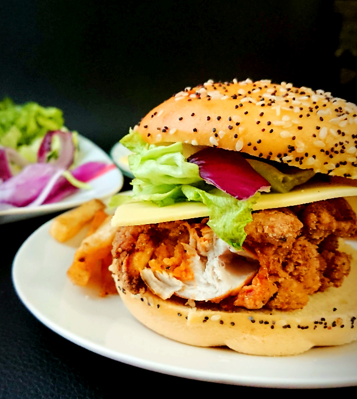 fried chicken burger with gluten free bun on a plate