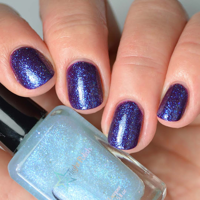blue fleck nail polish topper swatched over purple four finger swatch