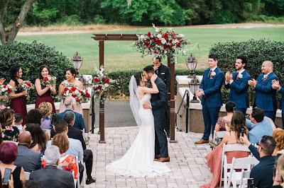 wedding kiss at ceremony