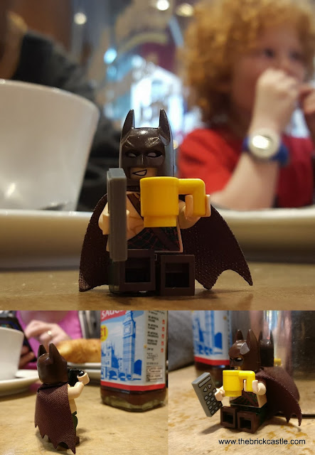 Tartan Batmandrinking a coffee taking a photo