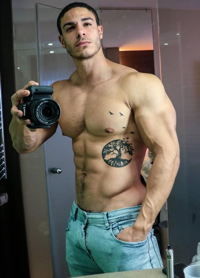 shirtless-beautiful-tattoo-body-beefcake-bro-perky-nips-pecs-huge-triceps-selfie-jeans