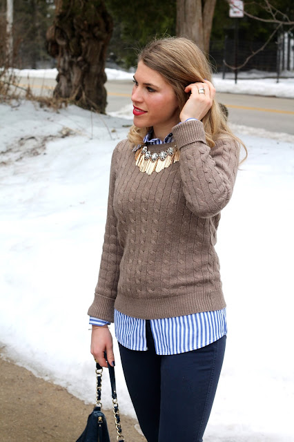 striped button up under cable knit sweater with navy pants and leopard flats