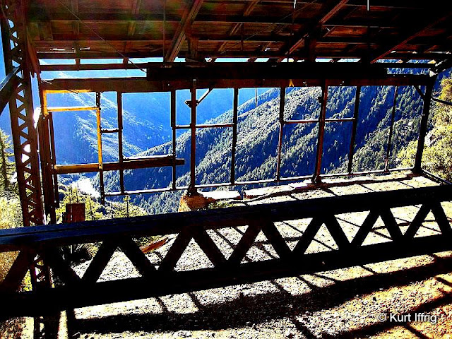 This is a view from inside the Big Horn Mine's stamp mill enclosure, looking down toward Mine Gulch.