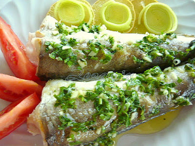 Cooked hake with parsley, garlic and lemon