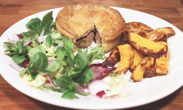 Wilfred's Welsh pie with salad and chips on white plate