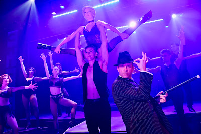 """Razzle Dazzle"" musical number  Keith Pinto (foreground as ""Billy Flynn"") alongside  Matthew Kropschot, Monica Moe, Jacqueline Neeley,  Jill Miller, Zoey Lytle, Tracey Freeman-Shaw,  Tony Wooldridge, Nick Rodrigues  Photo by Dave Lepori"