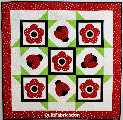 ladybugs and flowers with black and green accents in Ladybug Dance wall hanging pattern by QuiltFabrication