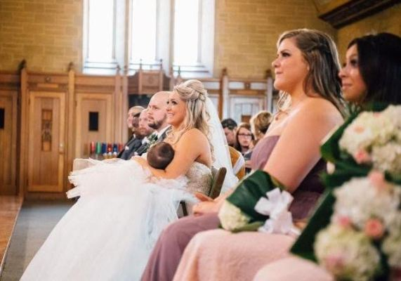 Beautiful photo of bride breastfeeding during her wedding ceremony goes viral