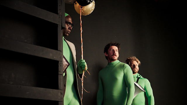 The movie crew in green screen suits